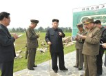 Kim Jong Un (3rd L) gestures whilst issuing instructions on the design of the Mirim Riding Club in east Pyongyang.  Also seen in attendance is Hwang Pyong So (L), Deputy Director of the KWP Organization Guidance Department (Photo: Rodong Sinmun).