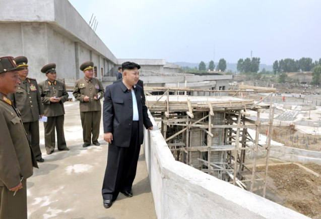 Kim Jong Un watches the progress of the construction of the outdoor pool and water amusements at Munsu Wading Pool in Pyongyang (Photo: Rodong Sinmun).