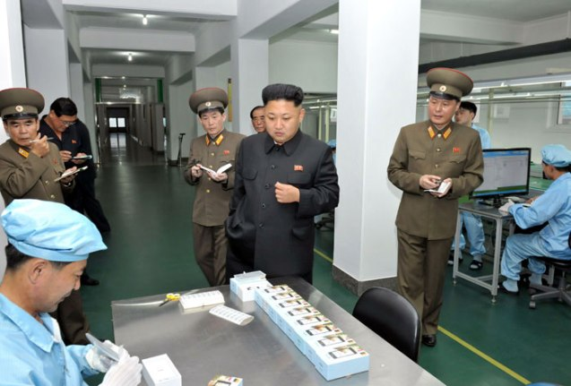 Kim Jong Un tours the assembly shop at 11 May Factory (Photo: Rodong Sinmun).
