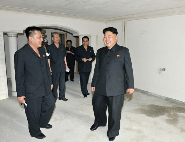 Kim Jong Un (R) tours a residential unit in one of two apartment towers earmarked for KIS University science faculty and researchers.  Also seen in attendance is architect and party construction boss Ma Won Chun (L) (Photo: Rodong Sinmun).