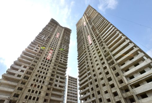 A view of the two apartment towers under construction in Pyongyang (Photo: Rodong Sinmun).