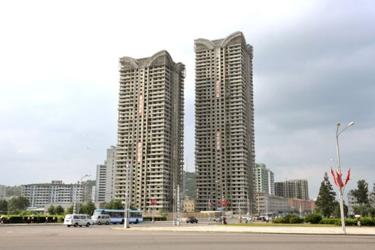 Two apartment towers under construction by KPA Unit #267.  The apartments are designated for KIS University science faculty and researchers (Photo: Rodong Sinmun).