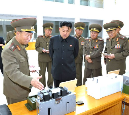 Kim Jong Un views products during a visit to the KPA Scientific and Technology Exhibition Hall (Photo: Rodong Sinmun).