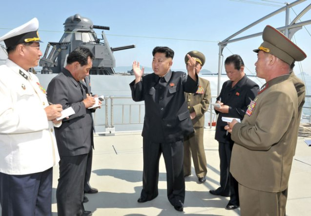 Kim Jong Un (3rd L) issues instructions during a field inspection of a newly commissioned KPA Navy warship (Photo: Rodong Sinmun).