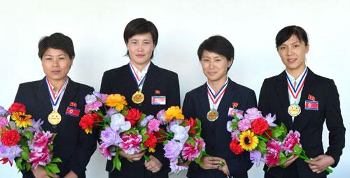 DPRK women boxers Ri Hwang Mi, Ri Kwang Suk, U Yong Gum and Kim Hwang Mi who participated in the 3rd Taipei City Cup invitational international boxing tournament held during 15-18 August 2013 (Photo: Rodong Sinmun).