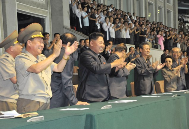 Kim Jong Un (3rd L) applauds during a men's premier league soccer (football) game at Kim Il Sung stadium in Pyongyang on 28 August 2013 (Photo: Rodong Sinmun).