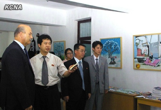 Czech Ambassador to the DPRK Dušan Štrauch (L) tours the DPRK Czech Friendship Pot'onggang District Segori Senior Secondary School prior to a cultural event marking the 65h anniversary of DPRK-Czech diplomatic relations (Photo: KCNA).