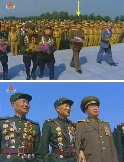 Top image: Ju Sang Song brings a floral bouquet to the memorial to Kim Jong Su, mother of KWP Secretary and Political Bureau Member Kim Kyong Hui and her brother late DPRK leader Kim Jong Il.  Bottom image: Ju Sang Song talks with fellow war veterans at the cemetery (Photos: KCTV screengrabs).