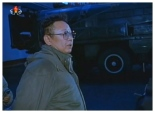 Late DPRK leader Kim Jong Il stands close to a TEL carrying a version of the Nodong medium-rang ballistic missile during a guidance visit that appears to be from the early 2000s.  The image is from a documentary film aired  by DPRK state media to mark the 53rd anniversary of Military-First (So'ngun) Revolutionary Leadership (Photo: KCTV screengrab).