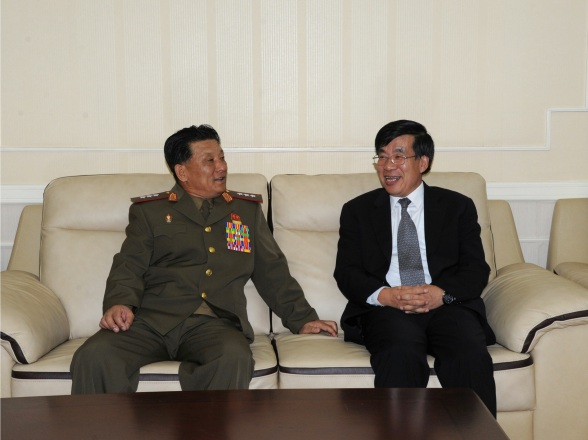 Vice Minister of the People's Armed Forces Col. Gen. Kang P'yo Yong (L) meets with PRC Ambassador to the DPRK Liu Hongcai (R) on 1 August 2013, prior to a reception commemorating the 86th anniversary of the foundation the Chinese People's Liberation Army (Photo: PRC Embassy in the DPRK).