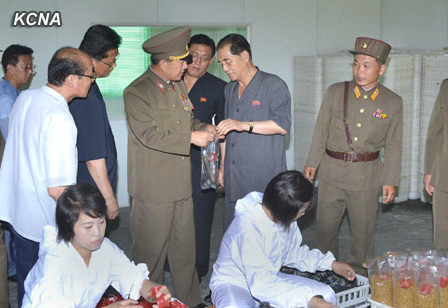 DPRK Premier Pak Pong Ju (2nd R) inspects products at a mushroom production site managed by the Korean People's Army (Photo: KCNA).