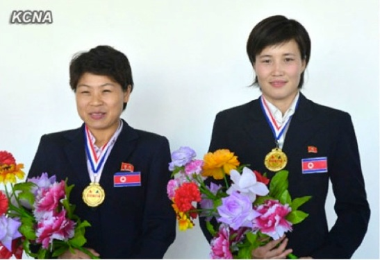 DPRK women boxers Ri Hyang Mi (L) and Ri Kwang Suk (R) placed first in their respective weight categories at the 3rd Taipei City Cup international tournament held during 15-18 August 2013 (Photo: KCNA).