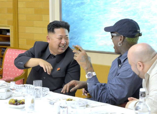 Kim Jong Un (L) talks with Dennis Rodman at a dinner party held during Rodman's visit to the DPRK (Photo: Rodong Sinmun).