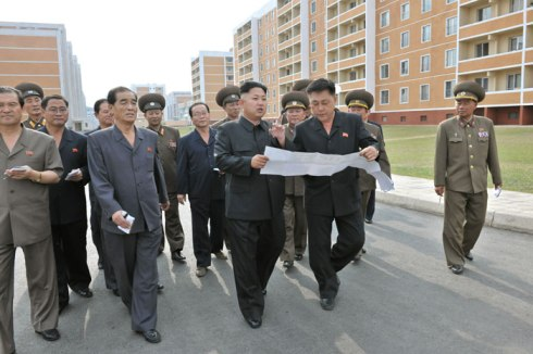 Kim Jong Un view blue prints with KWP Deputy Director Ma Won Chun (2nd R) during a visit to the U'nha Scientists' Street (Photo: Rodong Sinmun).