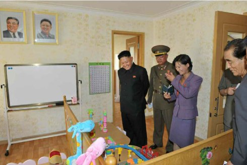 Kim Jong Un visits a child care center at the U'nha Scientists' Street (Photo: Rodong Sinmun).