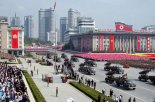 Towed multiple-launch rocket systems ride through Kim Il Sung Square in Pyongyang on 9 September 2013 (Photo: Rodong Sinmun).