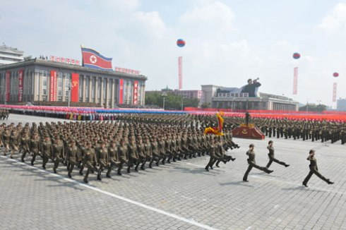 Members of the Worker-Peasant Red Guard march through Kim Il Sung Square in Pyongyang during a parade marking the 65th anniversary of the DPRK's foundation (Photo: Rodong Sinmun).
