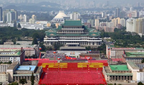 View of the Grand People's Study House overlooking Kim Il Sung Square in Pyongyang on 9 September 2013 during a parade and demonstration marking the 65th anniversary of the country's foundation.  Also viewable in this image behind the study house are the KWP Organization Guidance Department, the Pyongyang Ice Rink and the Red Wall Apartments (inhabited by KWP Secretaries) (Photo: Rodong Sinmun).