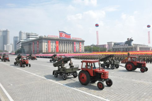 Red tractors tow multiple-launch rocket systems (MLRS) through Kim Il Sung Square on 9 September 2013 as part of the WPRK parade (Photo: Rodong Sinmun).