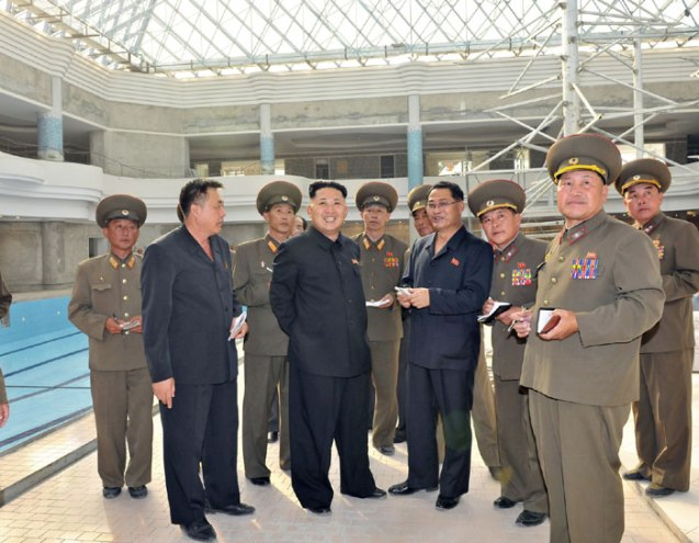 Kim Jong Un (4th L) visits the construction of the Munsu Swimming Complex (formerly known as the Munsu Wading Pool) in Pyongyang (Photo: Rodong Sinmun).