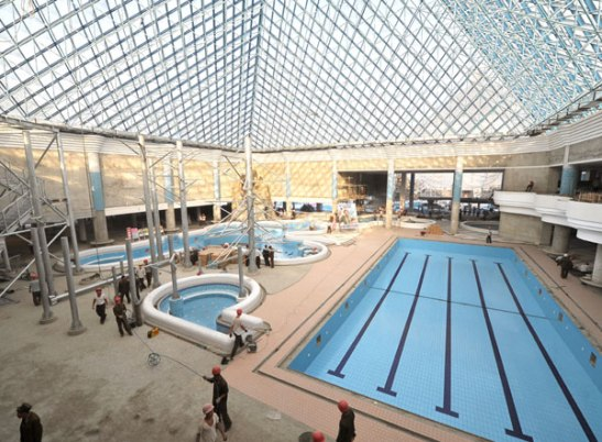 A view of indoor swimming pools within one of the three pyramids under construction at Munsu Swimming Complex in Pyongyang (Photo: Rodong Sinmun).