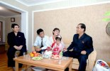 DPRK Premier Pak Pong Ju (R) visits a family at the U'nha Scientists' Street in Pyongyang on 18 September 2013 (Photo: Rodong Sinmun).