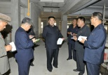 Han Kwang Sang (annotated) attends Kim Jong Un's recent visit to the Ryugyo'ng Dental Hospital (Photo: Rodong Sinmun).
