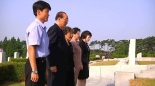 Supreme People's Assembly Presidium Vice President Yang Hyong Sop and members of his family visit a grave at the Patriotic Martyrs Cemetery in Pyongyang on 19 September 2013.  Yang's wife (also seen in the image) is a member of the extended Kim Family (Photo: KCNA screengrab).