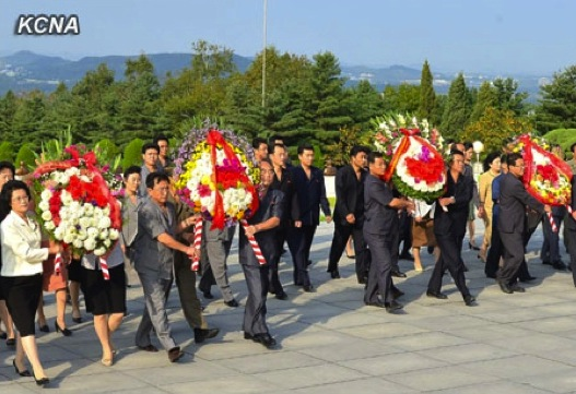 Floral wreaths delivered to the memorial bust of Kim Jong Suk to mark the 64th anniversary of her death in Pyongyang on 22 September 2013 (Photo: KCNA).