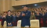 Kim Jong Un applauds after a performance by the Korean People's Internal Security Forces' Song and Dance Ensemble for the 65th anniversary of the DPRK's foundation, held at Ponghwa Art Theater in Pyongyang.  Also in attendance is his wife Ri Sol Ju (L) (Photo: KCTV screengrab).