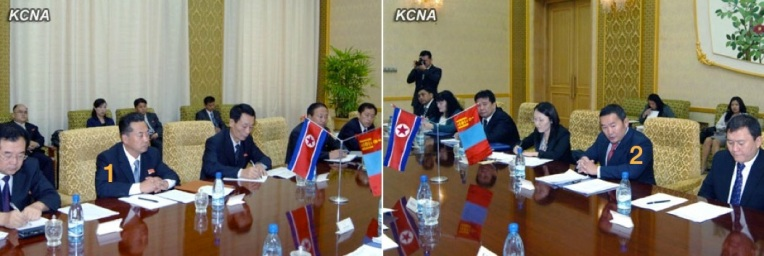 DPRK Minister of Foreign Trade Ri Ryong Nam (1) and Mongolian Minister of Industry and Agriculture Khlatmaa Battulga (2) attend the 9th meeting of the DPRK-Mongolian Consultative Committee on Economy, Trace, Science and Technology at Mansudae Assembly Hall in Pyongyang on 26 September 2013 (Photos: KCNA)