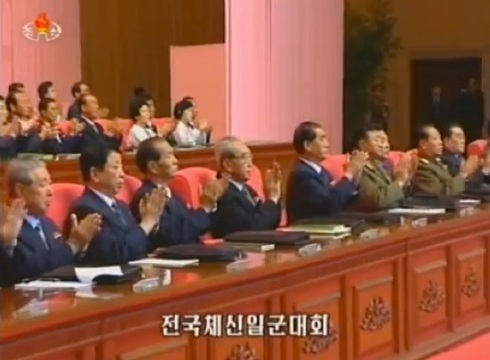 View of the leadership platform at the post and telecom workers' meeting in Pyongyang on 16 September 2013.  In this image are: Ju Kyu Chang, Ro Yu Chol, Kwak Pom Gi, Kim Ki Nam, Pak Pong Ju, Gen. Jang Jong Nam, Mun Kyong Dok and Gen. Choe Pu Il (Photo: KCTV screengrab).