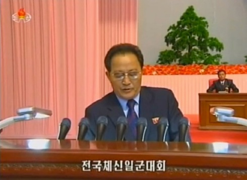 DPRK  Vice Premier Jon Sung Hun reads the meeting's official report (Photo: KCTV screengrab).