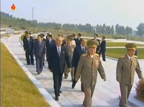 Senior DPRK officials including KPA General Political Department Director VMar Choe Ryong Hae, NDC Vice Chairman Ri Yong Mu, KWP Secretary Kim Ki Nam and SPA Presidium Vice President Yang Hyong Sop walk through the Fatherland Liberation War Martyrs' Cemetery in Pyongyang on 8 September 2013 (Photo: KCTV screengrab).