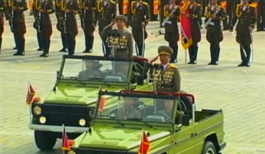 Minister of the People's Armed Forces Gen. Jang Jong Nam (foreground) presents Worker-Peasant Red Guard members to participate in a parade marking the 6th anniversary of the foundation in Pyongyang on 9 September 2013 (Photo: KCTV screengrab).