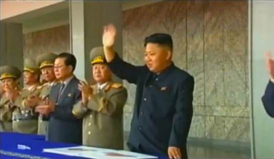 Kim Jong Un waves to a parade and demonstration held to mark the 65th anniversary of the DPRK's foundation in Pyongyang on 9 September 2013.  Also seen in attendance are: VMar Kim Yong Chun, Gen. Jang Jong Nam, Gen. Ri Yong Gil, Jang Song Taek and VMar Choe Ryong Hae (Photo: KCTV still).