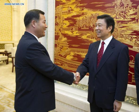 Jon Yong Nam (L), Chairman of the Kim Il Sung Socialist Youth League Central Committee, shakes hands with Chinese Vice President Li Yuanchao (R) at the Great Hall of the People in Beijing on 18 October 2013 (Photo by Xie Huanchi, Xinhua News Agency).