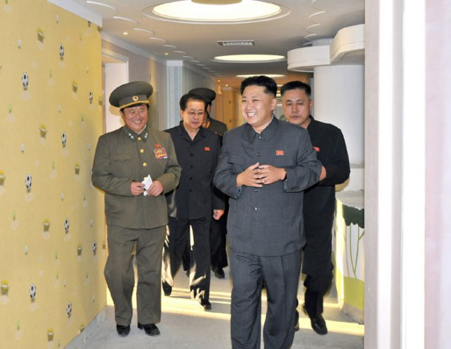 Kim Jong Un (3rd L) tours the construction of the Okryu Children's Hospital in east Pyongyang.  Also seen in attendance is Jang Song Taek (2nd L), NDC Vice Chairman and KWP Administration Department Director, and Ma Wo'n-ch'un (4th L), deputy director of the KWP Finance and Accounting Department (Photo: Rodong Sinmun).