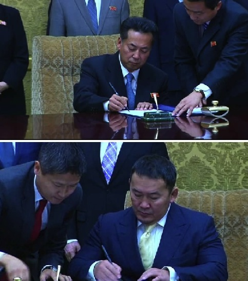 DPRK Minister of Foreign Trade Ri Ryong Nam and Mongolian Minister of Industry and Agriculture Khaltmaa Battulga sign an economic cooperation agreement in Pyongyang on 28 October 2013 (Photos: KCNA screen grabs).
