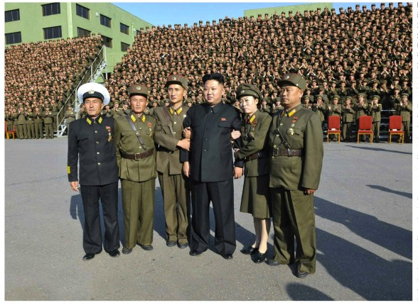 Kim Jong Un (4th L) poses for a commemorative photo in Pyongyang on 23 October 2013 with participants in the 4th Meeting of KPA Company Commanders and Political Instructors (Photo: Rodong Sinmun).