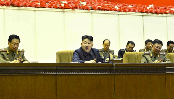 Kim Jong Un (C) speaks during a practical shooting competition of particpants in the 4th Meeting of KPA Company Commanders and Political Instructors.  Also seen in attendance are VMar Choe Ryong Hae (L), Director of the KPA General Political Department, and Gen. Ri Yong Gil (R), Chief of the KPA General Staff (Photo: Rodong Sinmun).