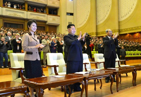 Kim Jong Un (C) and his wife Ri Sol Ju (L) applauds during a performance by Russia's Orchestra of the 21st Century, given to mark the 65th anniversary of DPRK-Russia relations at the East Pyongyang Grand Theater on 15 October 2013.  Also seen in attendance is KWP Secretary Kim Ki Nam (R) (Photo: Rodong Sinmun).