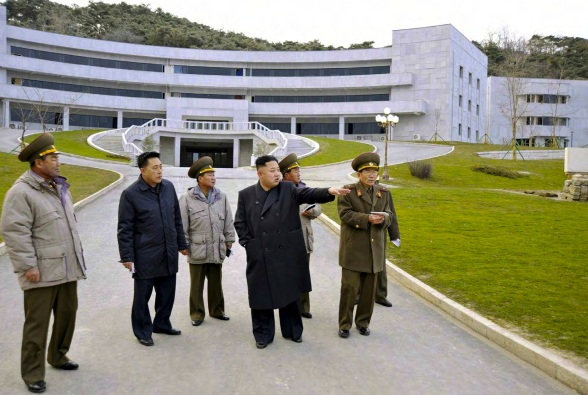 Kim Jong Un tours the construction of the Kim Jong Il Military Graduate School in Pyongyang.  Also seen in attendance is VMar Kim Jong Gak (L), a university chancellor who served as Minister of the People's Armed Forces from April 2012 to November 2012 and senior deputy director of the KPA General Political Department from 2007 to 2012 (Photo: Rodong Sinmun).