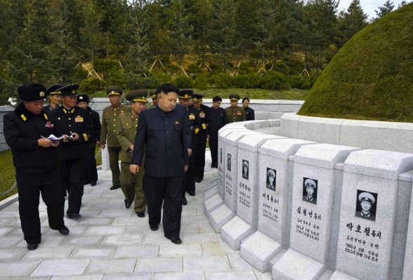 Kim Jong Un and senior KWP and KPA officials view the graves in a KPA Navy cemetery constructed for personnel killed in action on a submarine chaser in October 2012 (Photo: Rodong Sinmun).
