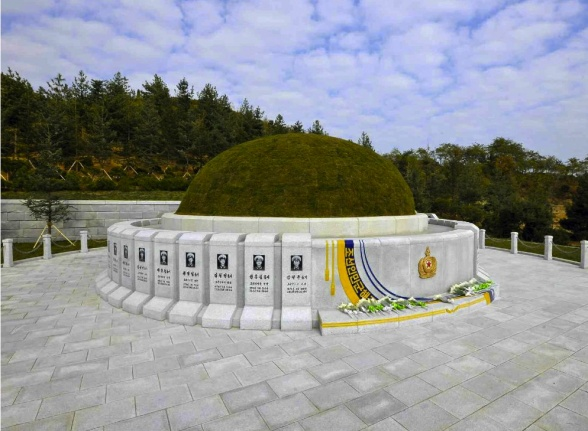A burial mound and memorial stones in the recently constructed KPA Navy Cemetery (Photo: Rodong Sinmun).