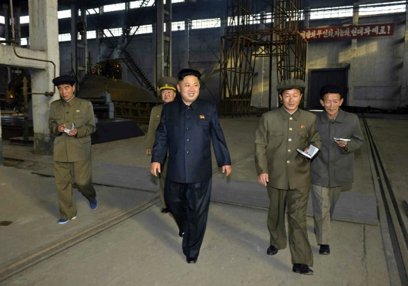 Kim Jong Un (C) tours a shipyard managed Chu So'ng-ho (Photo: Rodong Sinmun).
