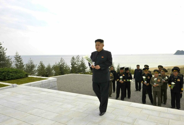 Kim Jong Un brings a bunch of flowers to a memorial at a cemetery for KPA Navy officers and service members killed in action in October 2012 (Photo: Rodong Sinmun).