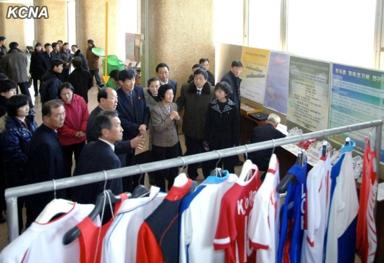 Minister of Physical Culture and Sports Ri Jong Mu (highlighted) tours the National Exhibition of Sports Science and Technology in Pyongyang on 19 November 2013 (Photo: KCNA).