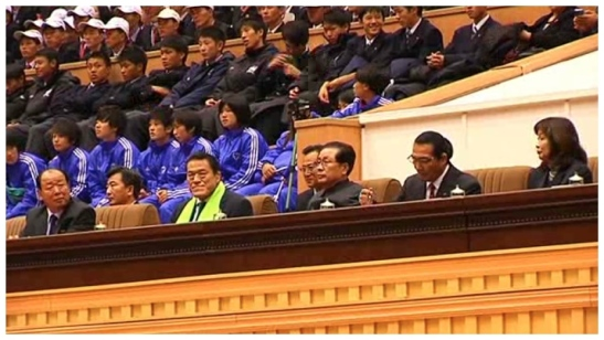 Jang Song Taek, Kanji Inoki and a Japanese sports delegation watch a women's university basketball game at Pyongyang Indoor Stadium on 6 November 2013 (Photo: KCNA screen grab).