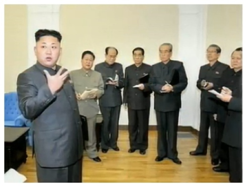 VMar Choe Ryong Hae (2nd L) with Kim Jong Un (L) as KJU talks to senior KWP and DPRK Government officials after the KWP Political Bureau meeting.  (Photo: KCTV screengrab).